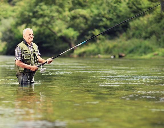 elderly fisherman fishing